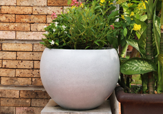 Outdoor setting with ModStone Moon Pot in Whitestone