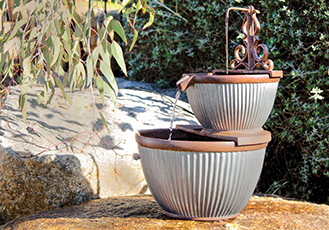 Water Magic Rib Amphora Fountain on decking